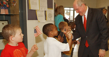 Governor Sonny Perdue greeting children